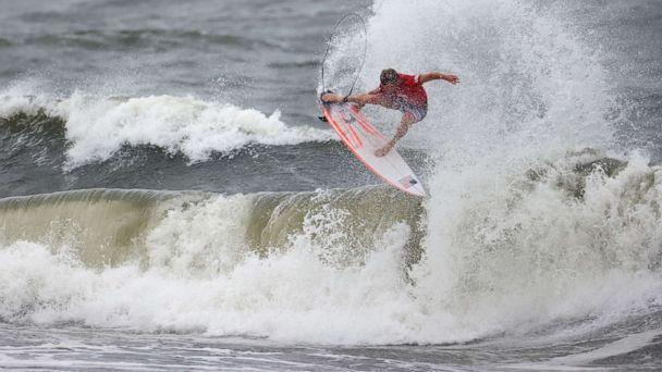 PHOTO: Kolohe Andino of the United States is shown in action during Heat 2 of the Men's Shortboard Surfing competition at the Tokyo 2020 Olympics, July 26, 2021, Tsurigasaki Surfing Beach, Tokyo. (Lisi Niesner/Reuters)