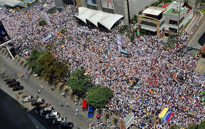 Anti-government protestors gather for a rally in Caracas, Venezuela, Saturday, Feb. 22, 2014. Venezuelans on both sides of the nation's political divide took to the streets on Saturday after nearly two weeks of mass protests that have President Nicolas Maduro scrambling to reassert his leadership. (AP Photo/Carlos Becerra)