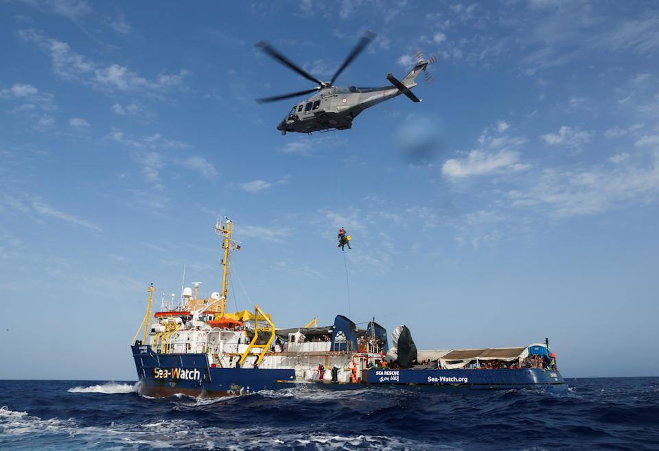 An Armed Forces of Malta helicopter medically evacuates a critically-ill Libyan boy and his family from the German NGO migrant rescue ship Sea-Watch 3 around 147 nautical miles south-west of Malta, in the western Mediterranean Sea, August 2, 2021. REUTERS/Darrin Zammit Lupi