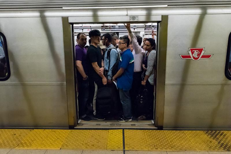 TORONTO, ONTARIO, CANADA - 2016/08/18: Toronto scenes: TTC subway train cramped with people ready to go to work. Many Torontonians prefer to use the public transit for its convenience. (Photo by Roberto Machado Noa/LightRocket via Getty Images)