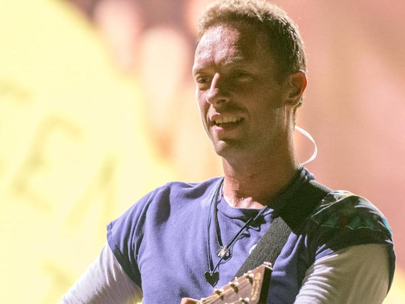 Chris Martin snaps at 'aggressive' autograph hunters outside charity concert