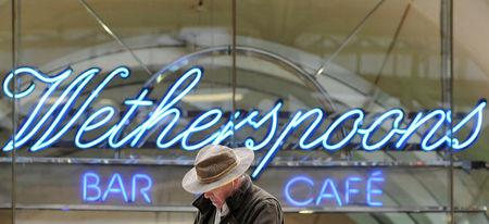 FILE PHOTO: A Wetherspoon's logo is seen at a bar in central London