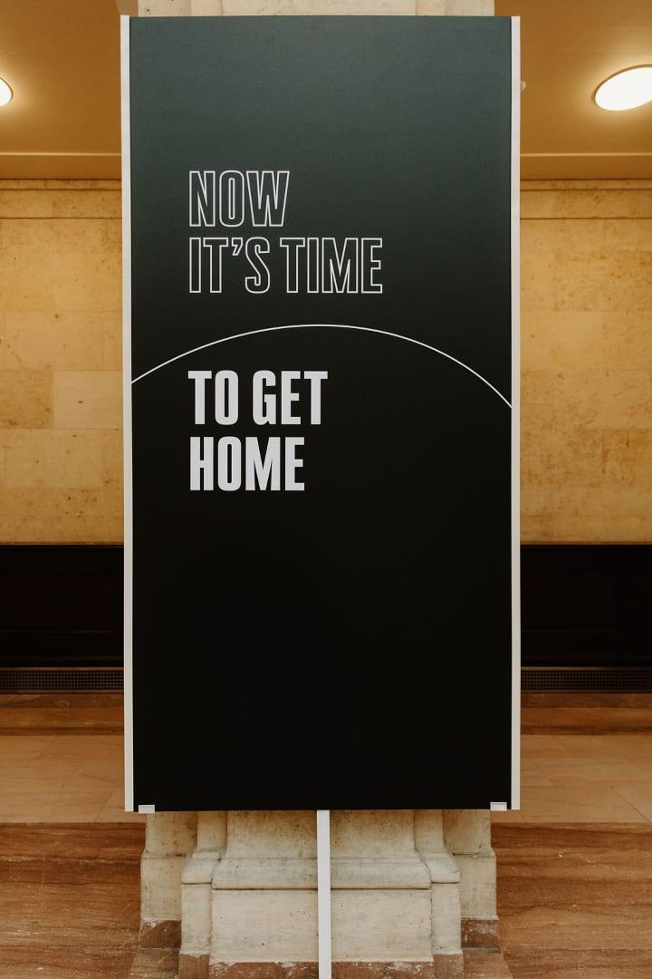 """White text on a black background that says """"NOW IT'S TIME TO GET HOME"""""""