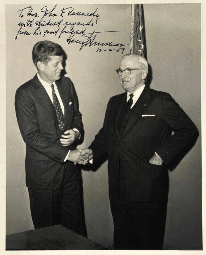 This Dec. 2, 1959 photo provided by John McInnis Auctioneers in Amesbury, Mass., shows late Presidents John F. Kennedy, left, and Harry Truman. The photograph is among items to be auctioned Sunday, Feb. 17, 2013. The family of David Powers, a former special assistant to President John F. Kennedy, is auctioning hundreds of photographs, documents, gifts and other memorabilia that once belonged to the late president. (AP Photo/John McInnis Auctioneers)