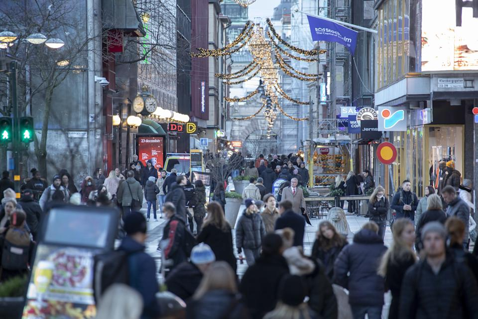 STOCKHOLM, SWEDEN, DECEMBER 23: People, some of them wearing face masks, walk past shops in Drottninggatan street, a famous commercial hub in Central Stockholm during the novel coronavirus Covid-19 pandemic in Stockholm, Sweden, December 23, 2020. The streets of Swedens capital remain busy amid new measurements instructed by Swedish authorities during the Christmas break. (Photo by Narciso Contreras/Anadolu Agency via Getty Images)