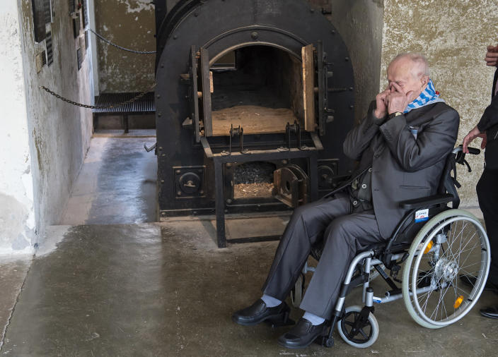 <p>Nazi concentration camp survivor Marian Wach of Poland holds his hands before his face in front of a crematory oven during the commemoration ceremonies for the 72th anniversary of the liberation of former Nazi concentration camp Mittelbau-Dora near Nordhausen, central Germany, Monday, April 10, 2017. (Photo: Jens Meyer/AP) </p>