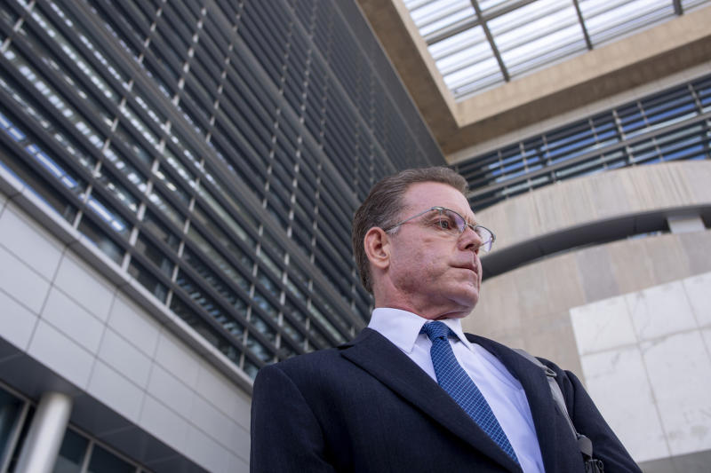 FILE - Douglas Haig leaves the Lloyd George Federal Courthouse, Tuesday Nov. 19, 2019, in Las Vegas, after pleading guilty to illegally manufacturing tracer and armor-piercing bullets found in a high-rise hotel suite where a gunman took aim before the Las Vegas Strip massacre two years ago. Haig was sentenced Tuesday, June 29, 2020 to 13 months in federal prison after selling home-loaded bullets to the gunman who killed 58 people in the Las Vegas Strip shooting in October 2017. Haig also was sentenced Tuesday in Las Vegas to three years of supervised release after pleading guilty last November to illegally manufacturing ammunition.(Elizabeth Page Brumley/Las Vegas Review-Journal via AP, File)