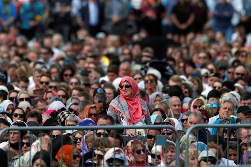 People attend the Friday prayers at Hagley Park outside Al-Noor mosque in Christchurch (REUTERS)