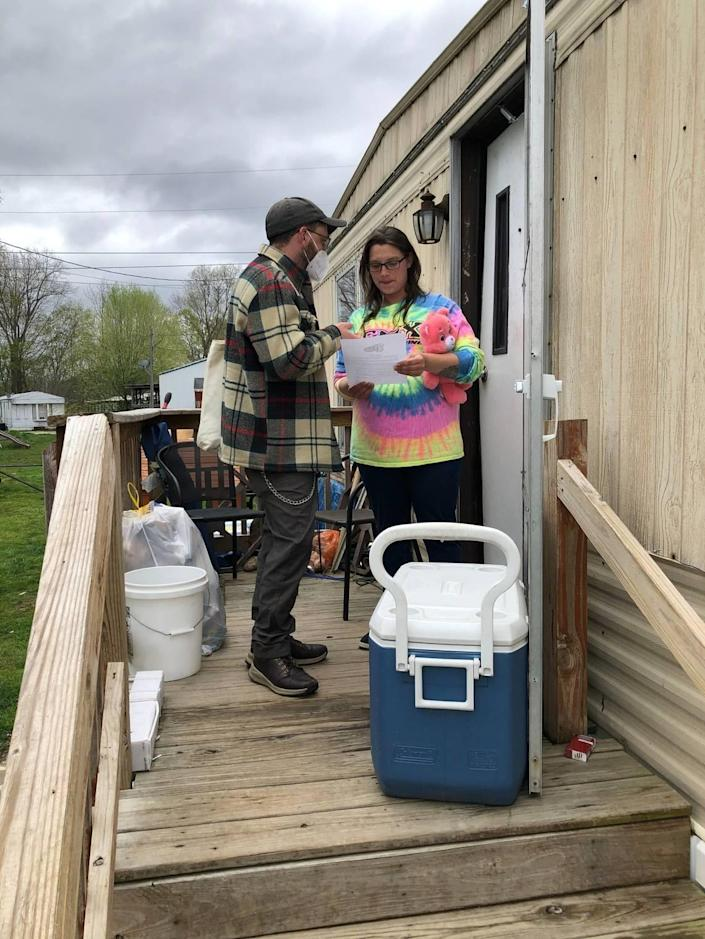 Community supporter Michael Harrington talks to Samantha Massey, a resident of North Fork mobile home park who is being evicted to make way for a new shopping center.
