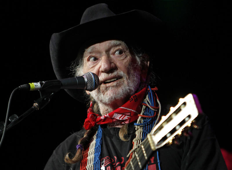 "FILE - Willie Nelson takes the stage during ""Fire Relief, The Concert For Central Texas"" at the Frank Erwin Center in Austin, Texas, in this Oct. 17, 2011 file photo. Country music legend Willie Nelson was expected to help unveil an eight-foot statue of himself in downtown Austin on Friday April 20, 2012, which happens to be a national day of protest for the legalization of marijuana. (AP Photo/Erich Schlegel, File)"