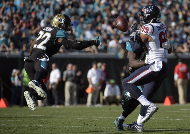 <p>Jacksonville Jaguars cornerback Aaron Colvin (22) breaks up a pass intended for Houston Texans tight end Stephen Anderson (89) during the first half of an NFL football game, Sunday, Dec. 17, 2017, in Jacksonville, Fla. (AP Photo/Phelan M. Ebenhack) </p>