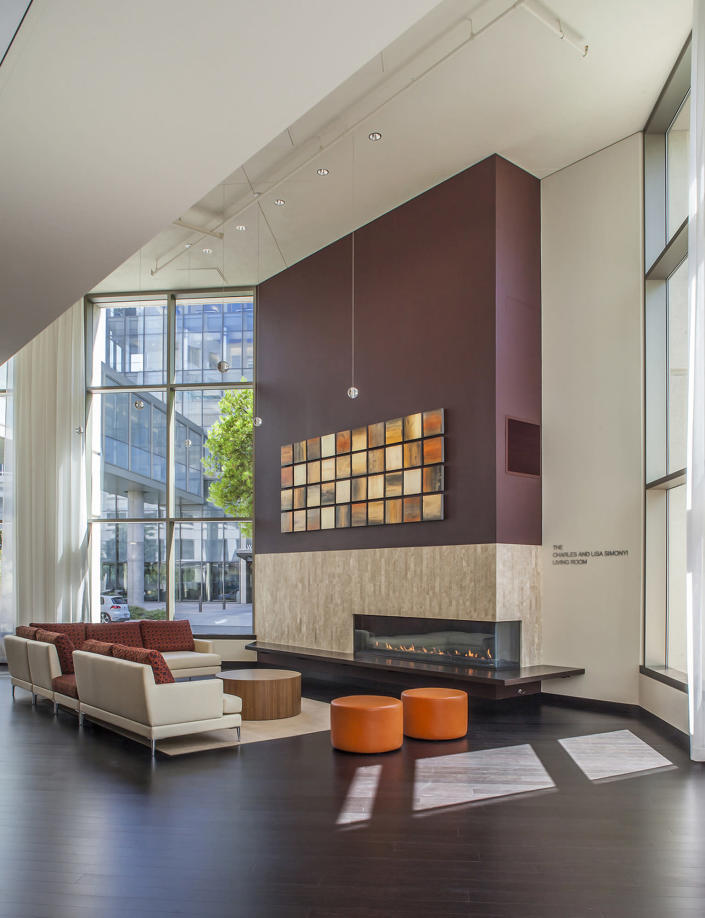 This undated photo provided by Perkns+Will shows the Lytle Center at Swedish First Hill Medical Center in Seattle, where a cozy fireplace welcomes visitors. (Eckert and Eckert Photography/Perkins+Will via AP)