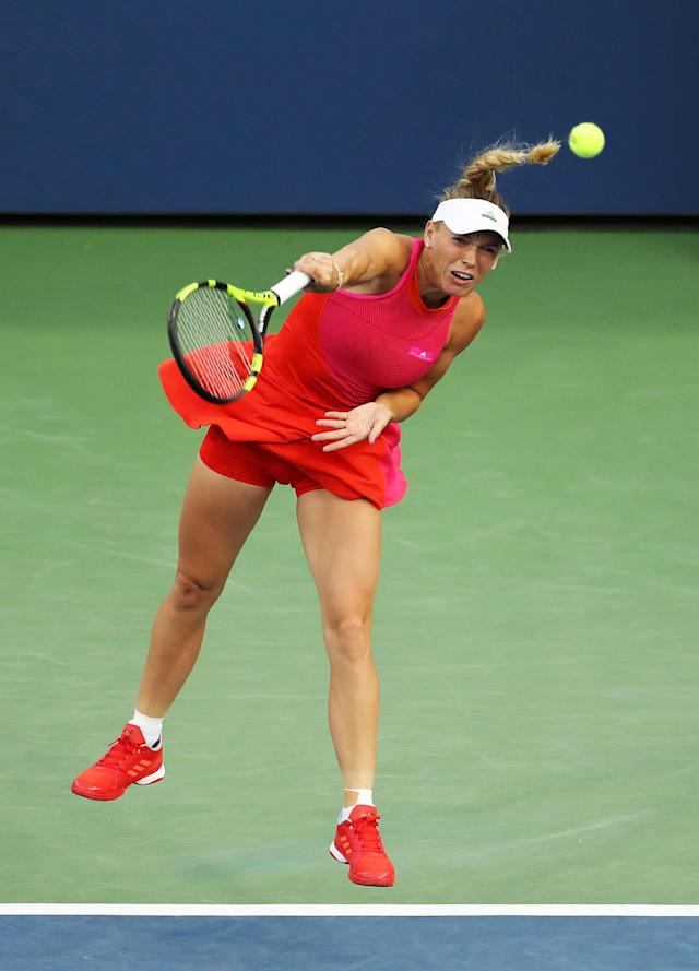 <p>Caroline Wozniacki of Denmark serves during her first round Women's Singles match against Mihaela Buzarnescu of Romania on Day One of the 2017 US Open at the USTA Billie Jean King National Tennis Center on August 28, 2017 in the Flushing neighborhood of the Queens borough of New York City. (Photo by Elsa/Getty Images) </p>