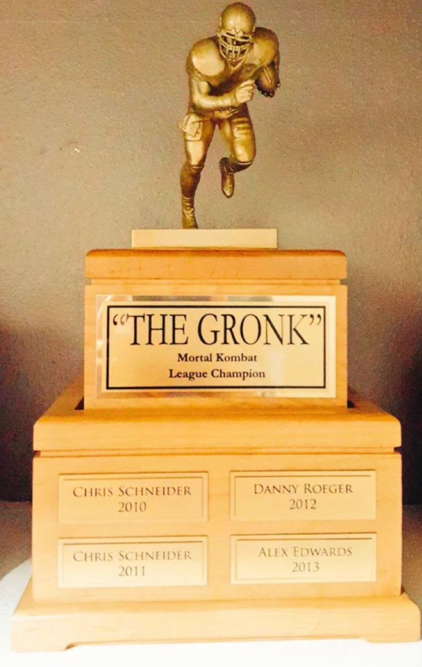The Mortal Kombat League competes for The Gronk, which they created with two pet urns and a plastic Gronk toy spray-painted gold. (Photo courtesy of The Mortal Kombat League)