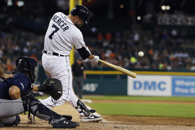 Detroit Tigers' Jordy Mercer connects for an RBI double during the fifth inning of a baseball game against the Seattle Mariners, Tuesday, Aug. 13, 2019, in Detroit. (AP Photo/Carlos Osorio)