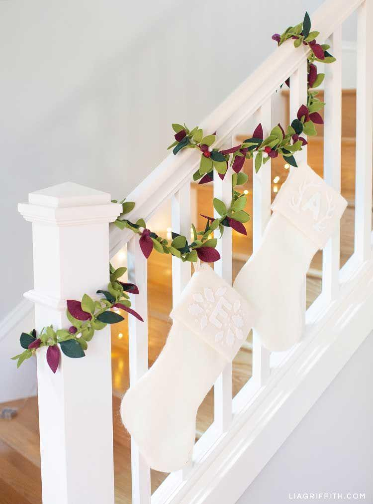 """<p><a href=""""https://liagriffith.com/felt-greenery-garland/"""" rel=""""nofollow noopener"""" target=""""_blank"""" data-ylk=""""slk:Lia Griffith"""" class=""""link rapid-noclick-resp"""">Lia Griffith</a>'s DIY garland makes the case for getting crafty ahead of the holiday season. A festive palette of reds and greens are paired with crisp white stockings for a pared down look. </p>"""