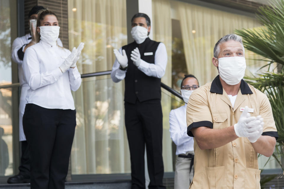 PALMA DE MALLORCA, SPAIN JUNE 15: Workers of the RIU Hotel in Mallorca welcome guests from Dusseldorf Germany on June 15, 2020. They are the first tourists to visit Spain since confinement began due to the COVID-19 crisis. The government of Spain has allowed the entry of 10,900 German tourists to the Balearic Islands on 47 flights throughout the entire month of June to test the viability of tourist recovery. (Photo by Joan Armengual/VIEWpress via Getty Images).