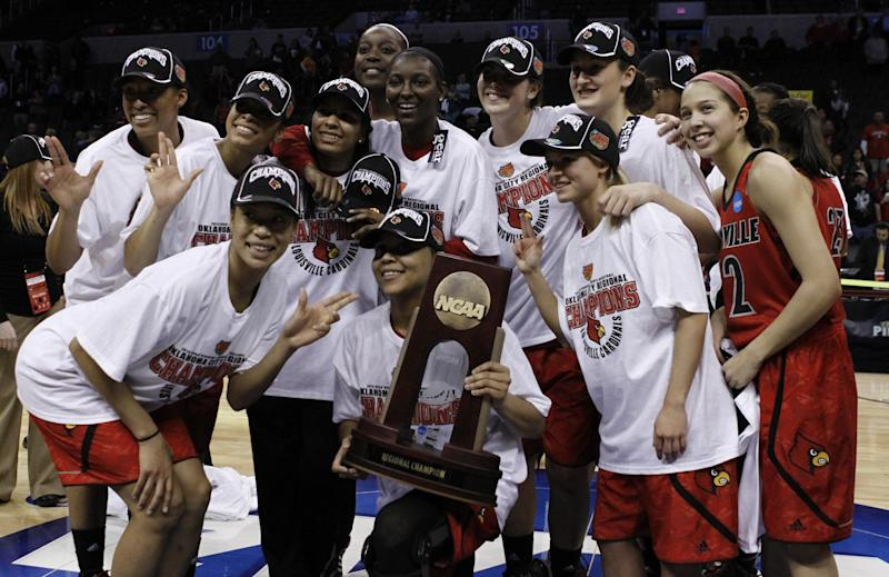 Louisville's team poses for a photo after defeating Tennessee during the Oklahoma City regional final game in the women's NCAA college basketball tournament in Oklahoma City, Tuesday, April 2, 2013.   Louisville own 86-78.  (AP Photo/Alonzo Adams)