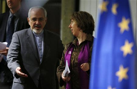 European Union foreign policy chief Ashton and Iranian Foreign Minister Mohammad Zarif arrive at a news conference at the end of the Iranian nuclear talks in Geneva