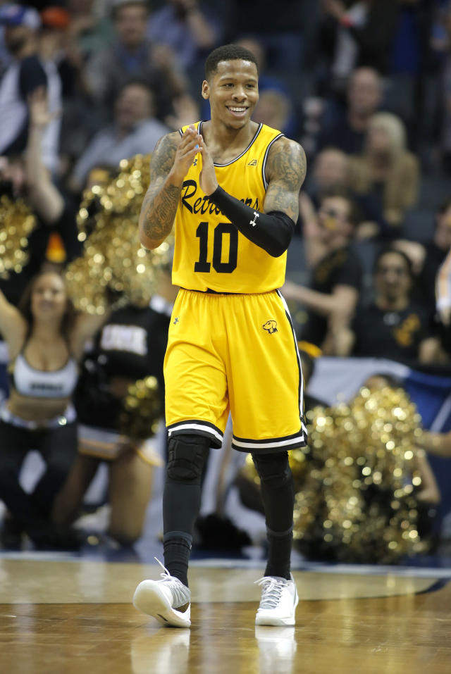 UMBC's Jairus Lyles celebrates during the second half of the team's first-round game against Virginia in the NCAA men's college basketball tournament in Charlotte, N.C., Friday, March 16, 2018. (AP Photo/Bob Leverone)