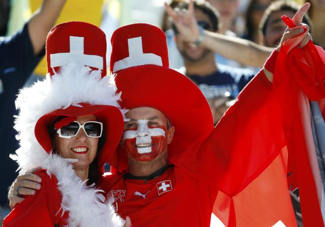 Fans of Switzerland cheer before their 2014 World Cup round of 16 game against Argentina at the Corinthians arena in Sao Paulo July 1, 2014. REUTERS/Paul Hanna (BRAZIL - Tags: SOCCER SPORT WORLD CUP)