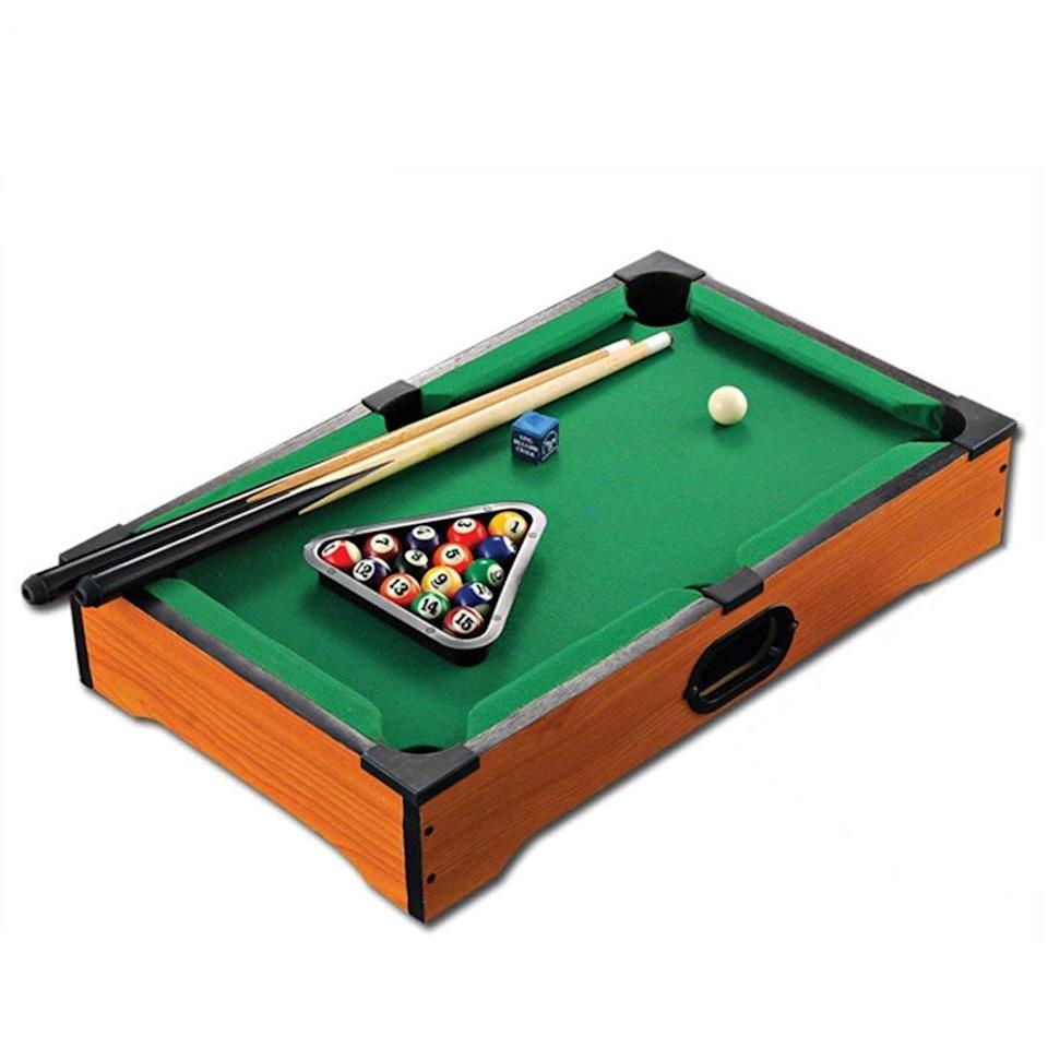 """<h2>Mini-Tabletop Pool Set<br></h2><br>Because <a href=""""https://www.refinery29.com/en-us/miniature-cuteness-gifts"""" rel=""""nofollow noopener"""" target=""""_blank"""" data-ylk=""""slk:smol items"""" class=""""link rapid-noclick-resp"""">smol items</a> bring so much joy. Pinkies up for this foot-long pool table, ideal for taking on-the-go. <br><br><strong>Wander Agio</strong> Mini-Tabletop Pool Set, $, available at <a href=""""https://www.amazon.com/Wander-Agio-Tabletop-Billiards-Billiard/dp/B07GLB2C48"""" rel=""""nofollow noopener"""" target=""""_blank"""" data-ylk=""""slk:Amazon"""" class=""""link rapid-noclick-resp"""">Amazon</a>"""