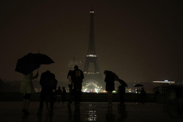 The lights of the Eiffel Tower in Paris were switched off on October 2, 2017 in tribute to the victims of the attacks in Las Vegas and Marseille, France. (LUDOVIC MARIN/Getty Images)
