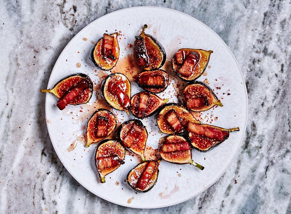 "This figs recipe is sweet, salty, sticky, and acidic—everything you want in a one-bite appetizer. <a href=""https://www.bonappetit.com/recipe/figs-with-bacon-and-chile?mbid=synd_yahoo_rss"" rel=""nofollow noopener"" target=""_blank"" data-ylk=""slk:See recipe."" class=""link rapid-noclick-resp"">See recipe.</a>"