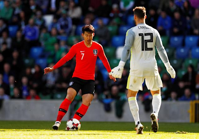 Soccer Football - International Friendly - Northern Ireland vs South Korea - National Football Stadium at Windsor Park, Belfast, Britain - March 24, 2018 South Korea's Son Heung-Min in action with Northern Ireland's Trevor Carson Action Images via Reuters/Jason Cairnduff