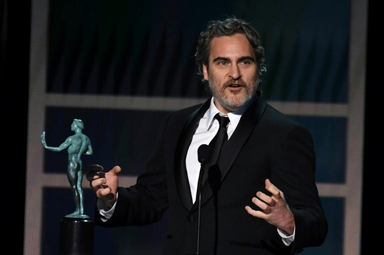 US actor Joaquin Phoenix accepts the award for Outstanding Performance by a Male Actor in a Leading Role during the 26th Annual Screen Actors Guild Awards show