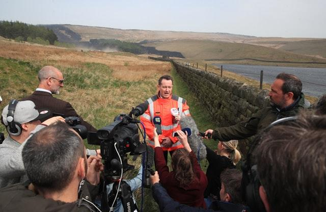 Phil Nelson speaks to the media near Delph, Greater Manchester