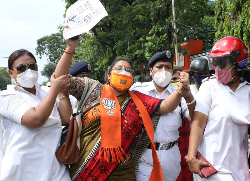 A supporter of India's ruling BJP reacts as she is detained by the police during a protest against China, in Kolkata