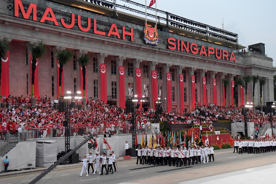 Spectators watch a procession during the 54th National Day Parade in Singapore on August 9, 2019. (Photo by Roslan RAHMAN / AFP)        (Photo credit should read ROSLAN RAHMAN/AFP via Getty Images)
