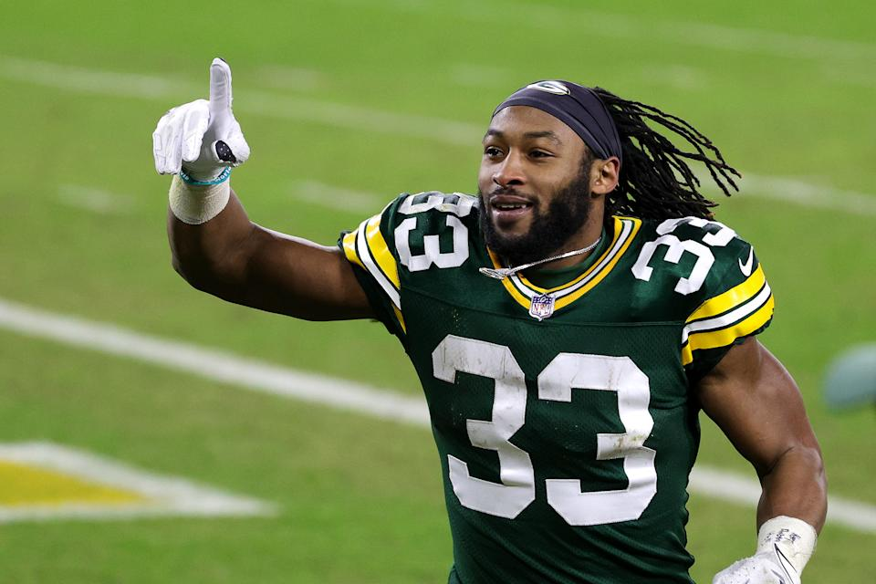 GREEN BAY, WISCONSIN - JANUARY 16: Aaron Jones #33 of the Green Bay Packers reacts after defeating the Los Angeles Rams 32-18 in the NFC Divisional Playoff game at Lambeau Field on January 16, 2021 in Green Bay, Wisconsin. (Photo by Stacy Revere/Getty Images)