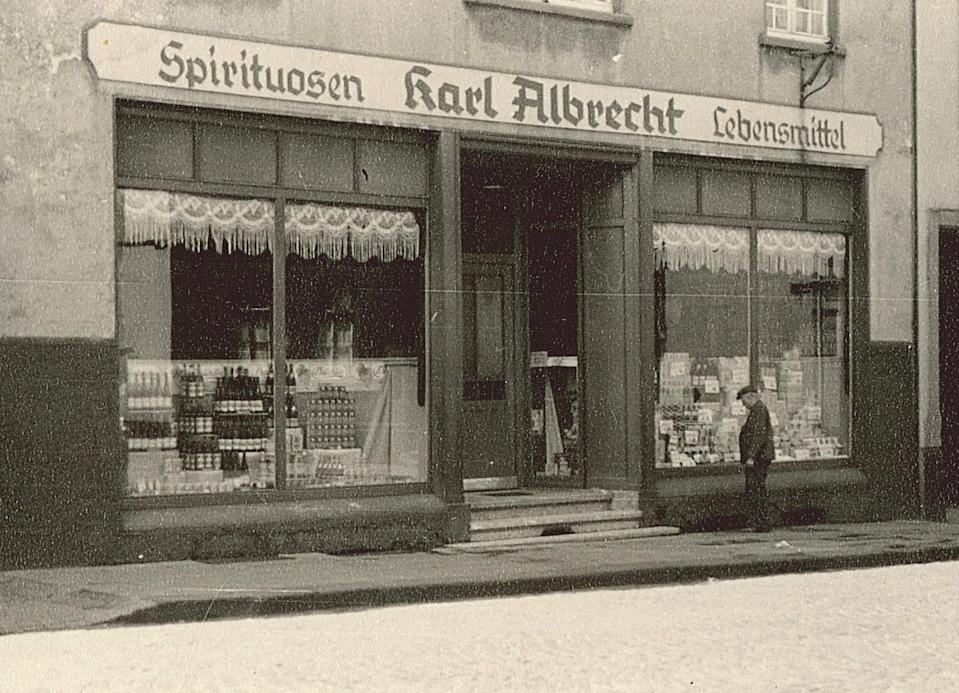 The image, dated 1930, of a general outside view of Karl Albrecht Spiritousen and Lebensmittel shop in Germany.  Source: Getty