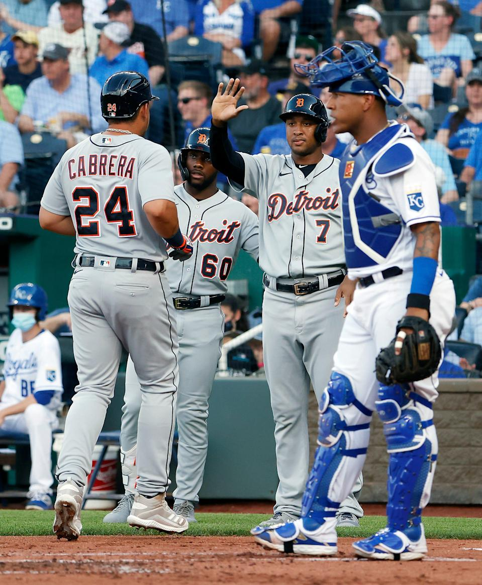 Miguel Cabrera of the Detroit Tigers is congratulated by Akil Baddoo and Jonathan Schoop after scoring during the 1st inning of the game against the Kansas City Royals at Kauffman Stadium in Kansas City, Missouri, on Monday, June 14, 2021.