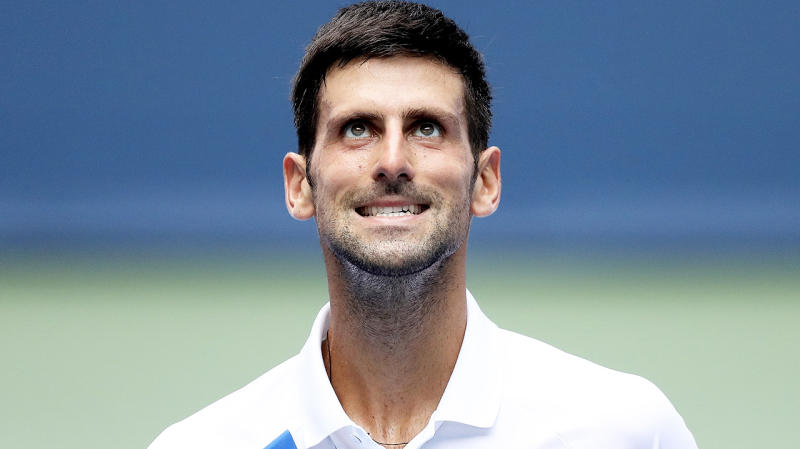 Novak Djokovic looking frustrated after a tennis point.