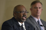 Former University of Michigan football player Gilvanni Johnson, foreground, answers a question from the media during a news conference, Thursday, June 10, 2021 in Novi, Mich. Seated next to him is attorney Dennis Mulvihill. Johnson said it was common knowledge among their teammates that Dr. Robert E. Anderson abused players during the mandatory physicals they had to get from him. (AP Photo/Jose Juarez)