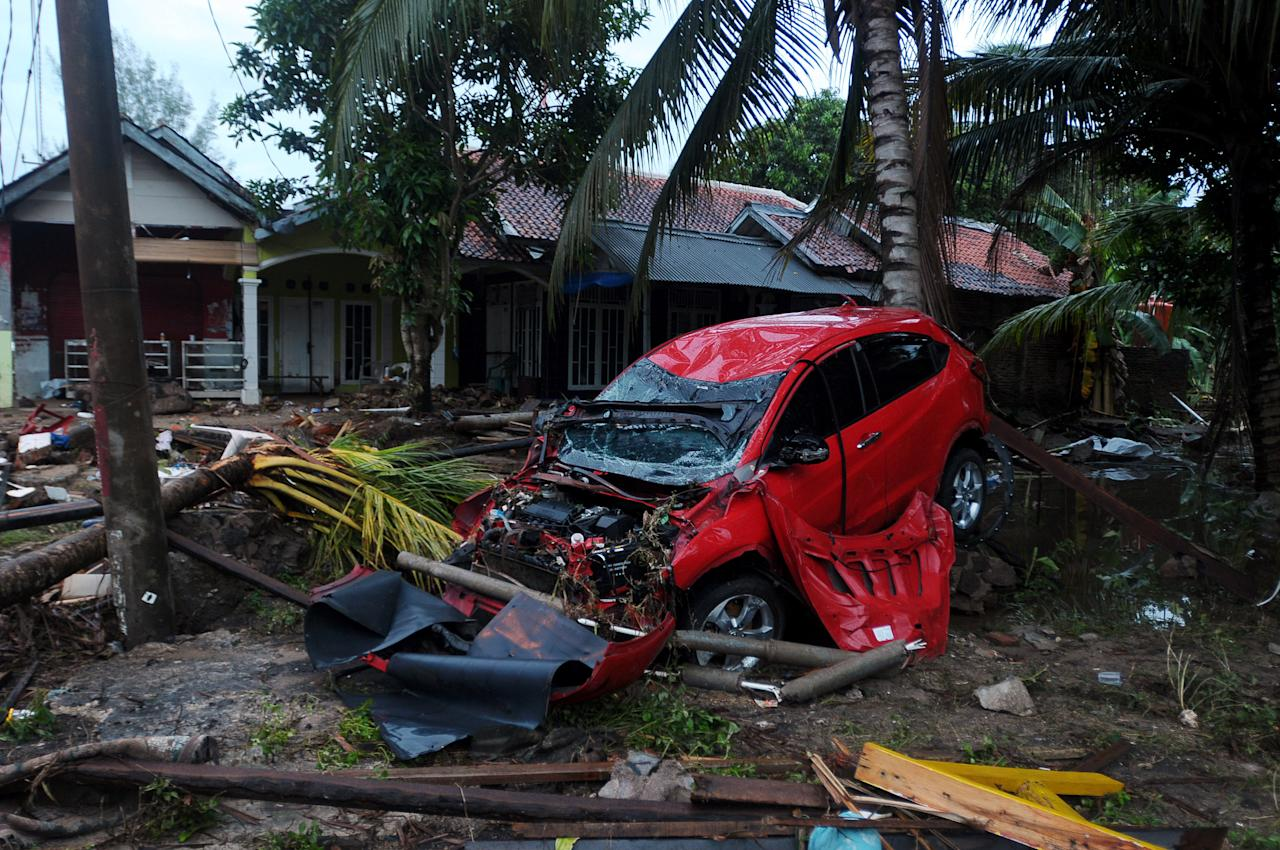 <p>A view of damaged buildings in Banten, on Dec. 23, 2018, after the area was hit by a tsunami on Dec. 22 following an eruption of the Anak Krakatoa volcano. A volcano-triggered tsunami has left at least 373 people dead and hundreds more injured after slamming without warning into beaches around Indonesia's Sunda Strait. (Photo by Dasril Roszandi/NurPhoto via Getty Images) </p>