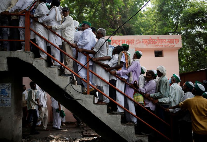 People arrive to attend a Maha Panchayat or grand village council meeting as part of a farmers' protest against farm laws in Muzaffarnagar