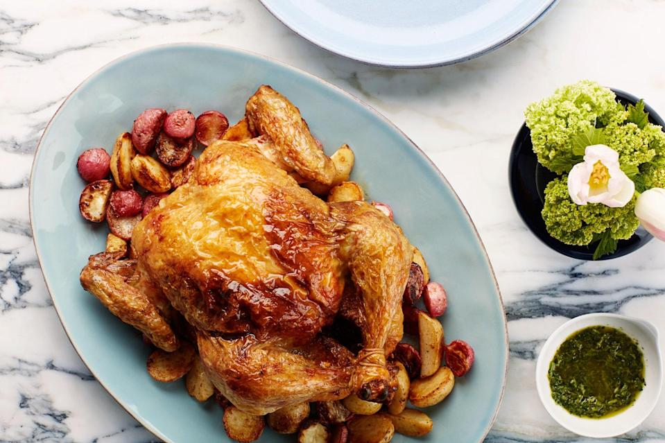 """Paprika-spiked mayonnaise adds rich flavor to this juicy one-pan roast chicken. <a href=""""https://www.epicurious.com/recipes/food/views/paprika-roasted-chicken-potatoes-and-radishes-with-salsa-verde?mbid=synd_yahoo_rss"""" rel=""""nofollow noopener"""" target=""""_blank"""" data-ylk=""""slk:See recipe."""" class=""""link rapid-noclick-resp"""">See recipe.</a>"""