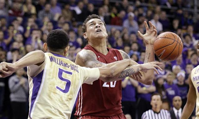 Washington's Nigel Williams-Goss (5) knocks the ball away Washington State's Jordan Railey during the first half of an NCAA college basketball game Friday, Feb. 28, 2014, in Seattle. (AP Photo/Elaine Thompson)