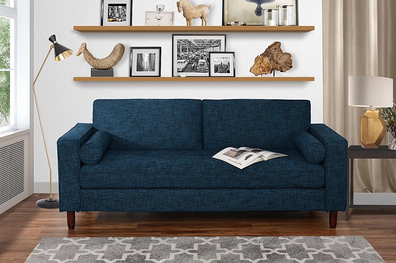 """<p>This <a href=""""https://www.popsugar.com/buy/Modern-Fabric-Sofa-Tufted-Linen-Fabric-415234?p_name=Modern%20Fabric%20Sofa%20With%20Tufted%20Linen%20Fabric&retailer=walmart.com&pid=415234&price=300&evar1=casa%3Auk&evar9=45950398&evar98=https%3A%2F%2Fwww.popsugar.com%2Fhome%2Fphoto-gallery%2F45950398%2Fimage%2F45950415%2FModern-Fabric-Sofa-Tufted-Linen-Fabric&list1=shopping%2Chome%20decor%2Cfurniture%2Cwalmart%2Chome%20shopping&prop13=api&pdata=1"""" rel=""""nofollow"""" data-shoppable-link=""""1"""" target=""""_blank"""" class=""""ga-track"""" data-ga-category=""""Related"""" data-ga-label=""""https://www.walmart.com/ip/Modern-Fabric-Sofa-with-Tufted-Linen-Fabric-Living-Room-Couch-Dark-Blue/780458694"""" data-ga-action=""""In-Line Links"""">Modern Fabric Sofa With Tufted Linen Fabric</a> ($300) looks way more expensive than it is.</p>"""