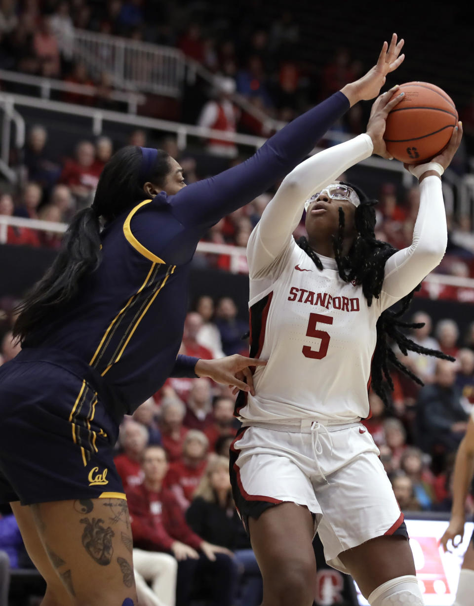 Stanford forward Francesca Belibi (5) shoots against California's CJ West, left, during the first half of an NCAA college basketball game Friday, Jan. 10, 2020, in Stanford, Calif. (AP Photo/Ben Margot)