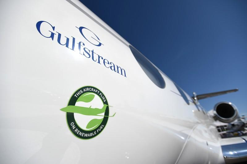 """A decal stating """"This Aircraft Flies On Renewable Fuel"""" is seen on on a Gulfstream 650ER business jet at the National Business Aviation Association (NBAA) exhibition in Las Vegas"""
