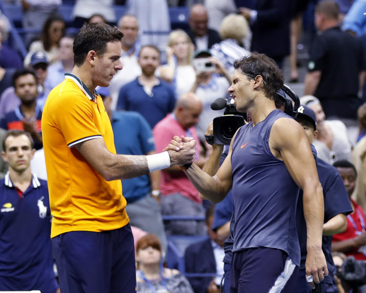 Juan Martin del Potro of Argentina shakes hands with Rafael Nadal of Spain after Nadal retired from the match during the semifinals of the U.S. Open tennis tournament Friday Sept. 7 2018 in New York
