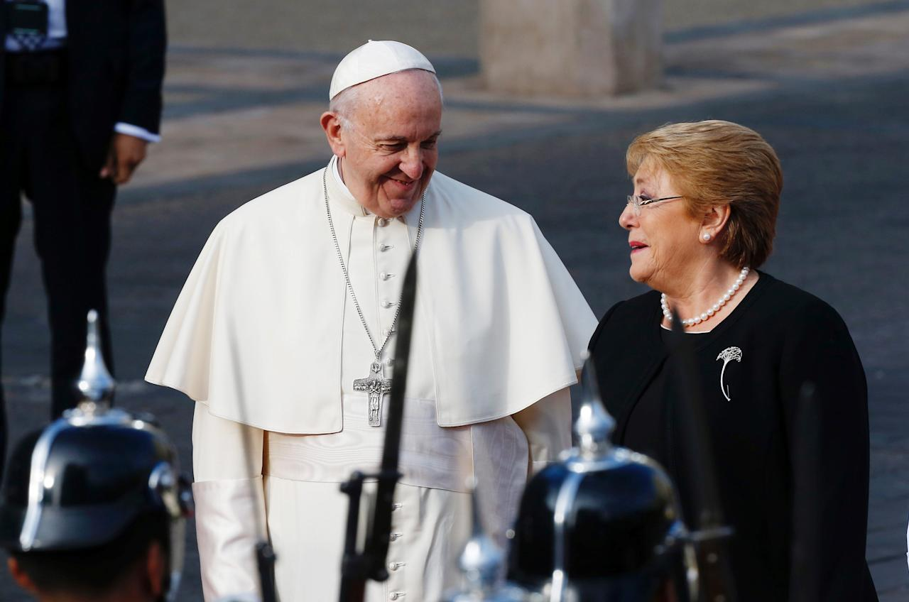 Pope Francis and Chile's president Michelle Bachelet speak outside the La Moneda Presidential palace during his visit in Santiago, Chile, January 16, 2018. REUTERS/Rodrigo Garrido