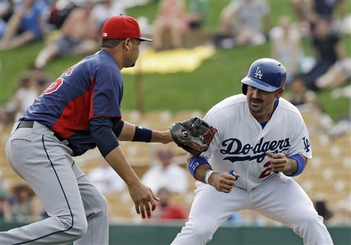 Los Angeles Dodgers' Adrian Gonzalez, right, is tagged out by Cleveland Indians shortstop Juan Diaz on a rundown in the fourth inning of an exhibition spring training baseball game Sunday, March 3, 2013, in Glendale, Ariz. (AP Photo/Mark Duncan)
