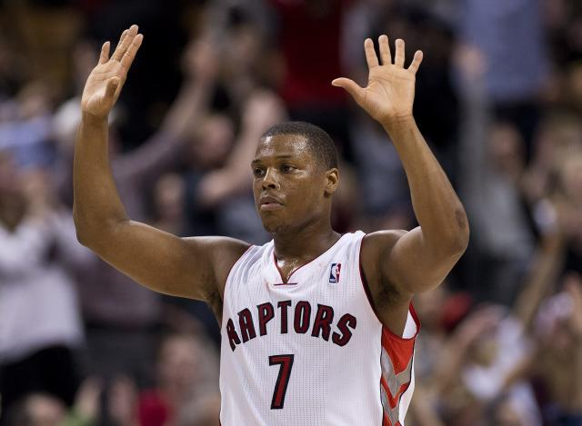 Toronto Raptors guard Kyle Lowry reacts after hitting a tipple against the Memphis Grizzlies during second half NBA basketball action in Toronto on Friday, March. 14, 2014. (AP Photo/The Canadian Press, Nathan Denette)