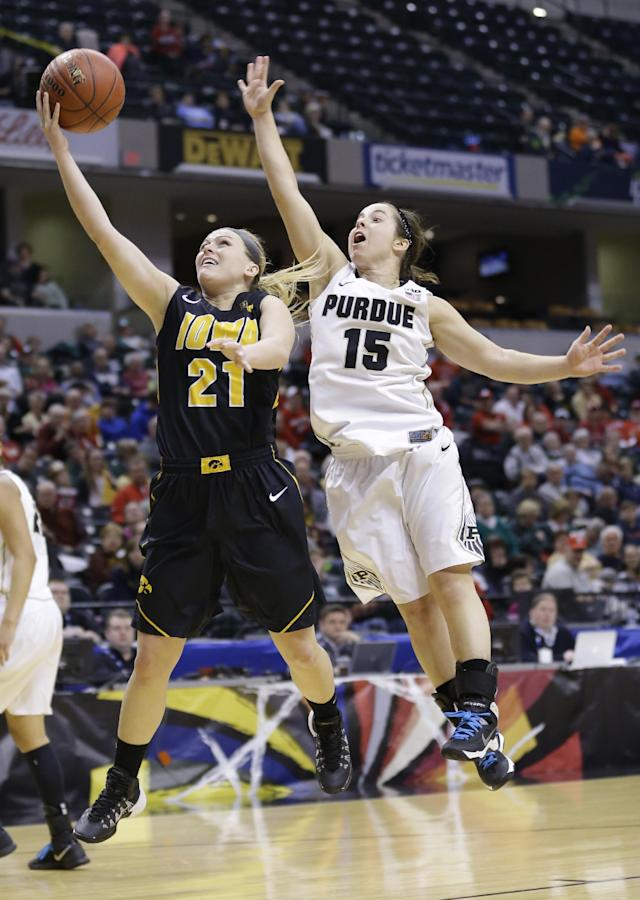 Iowa guard Melissa Dixon (21) shoots next to Purdue guard Courtney Moses during the second half of an NCAA college basketball game in the quarterfinals of the Big Ten women's tournament in Indianapolis on Friday, March 7, 2014. Iowa defeated Purdue 87-80. (AP Photo/Michael Conroy)